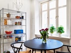 This apartment in Copenhagen clearly belongs to a film lover. Apart from several amazing Danish modern pieces of furnitu. Eames, Ikea Omar, Dining Room Inspiration, Mid Century Furniture, Danish Modern, Open Shelving, Scandinavian Design, Decoration, Dining Area