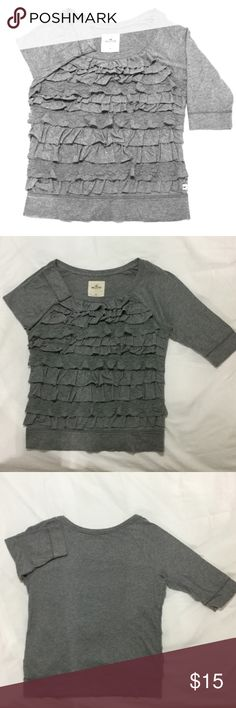 Hollister Ruffle Top Have some fun in this casual ruffled top. In good condition, features a combination of ruffles and lace. Offers some stretch. Material:60% Cotton, 40% Modal. Hollister Tops Tees - Long Sleeve