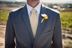 gray suit, striped tie