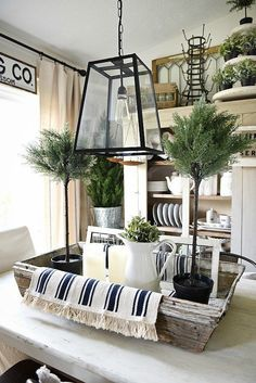 Cozy blankets, burlap, wood grain, chippy paint, shabby pottery, linens, greenery, metal buckets, vintage patina, glass, & some painted furniture add so much dimension and character that screams farmhouse.