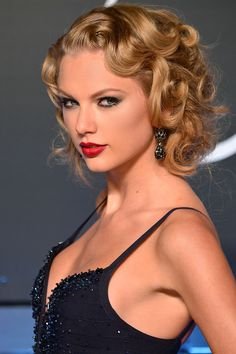 Serious curls pair perfectly with a plunging neckline at the MTV Video Music Awards.   - HarpersBAZAAR.com