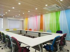 The bright colors trend has caught up with medical centers too - the colors and the interiors make this particular space look warm