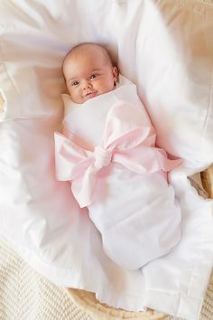 "Sweet Bow Swaddle Blanket, dying of a cuteness over load #TSM @Paula Stange Please @Paula Stange sugar Can you imagine this with ""Legacy"" embroidered on the bow? I'd die."