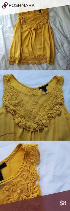 Mustard Yellow Tank top Chiffon type of material, elegant embroidery on the upper chest, light and flowy, there is a slight rip on the righr sleeve but is easily fixed if you know how to sew, still a beautiful top! Because of the rip, feel free to offer a different price than listed Forever 21 Tops Tank Tops