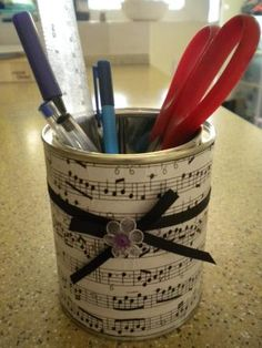You can use scrapbook paper and spray adhesive to make lovely organizers.