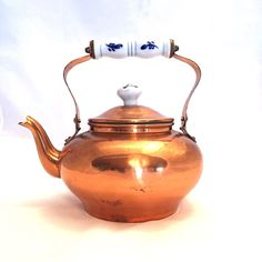 A personal favorite from my Etsy shop https://www.etsy.com/ca/listing/247853634/copper-teapot-delft-blue-ceramic-handle