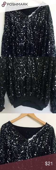 Onyx Black Sequined Vintage Bomber (XL) Lack oversized sequin vintage Bomber pullover with cashmere ribbing detail at hem line and wrist portion. Item is vintage there are no loose sequins on bodice or garment vintage Jackets & Coats