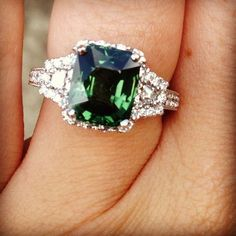 Emerald engagement ring Looks more like tsavorite or man made emerald?