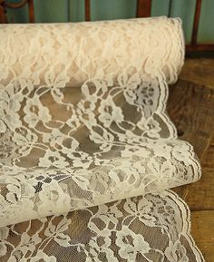 """Ivory lace in a 9"""" width -- great size for a table runner overlay...on top of linen or burlap."""