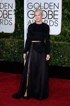 Robin Wright is just so cool. It doesn't matter if crop tops are kind of over (even though I am on #teamcroptop forever!), she wears this Ralph Lauren look with next season's skin-baring trend: the sexy slit! I'm into the collision of what's on its way out and what's next.   - ELLE.com