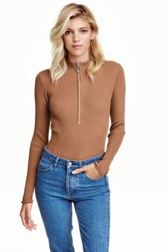 Turtleneck jumper with a zip: Fitted jumper in a soft, ribbed knit with a turtle neck and zip at the top.