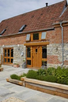 Brick and stone exterior of Somerset barn conversion, England, UK