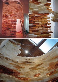 Hunk, & Dora (2006), Handmade paper brick tower: upwards of two thousand handmade paper bricks made from premium abaca, pigmented abaca, unbleached abaca, cotton, and linen; wood, monofilament, tyvek, buttons, sand. 14-foot tower, 6-foot doorway. by Aimee Lee