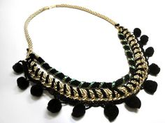 Pompom woven necklace in black and gold.