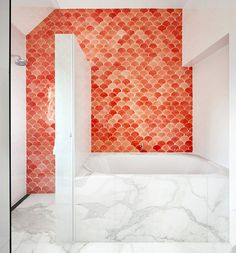 coral tile and marble in the bathroom