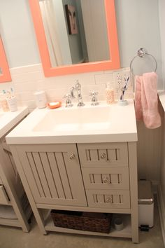 THE KIDS BATHROOM MAKEOVER IS DONE!!!!! There were a few finishing touches to do and some changes I made...but I FINALLY got in there and snapped away last night!!! The little coral/orange soap-dis...