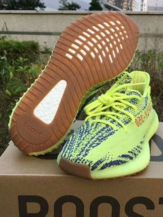96e31d9b1acf18 The adidas Yeezy Boost 350 Semi Frozen Yellow comes with a combination of  Yellow and Dark Grey on the Primeknit upper that is then placed on top of a  Yellow ...
