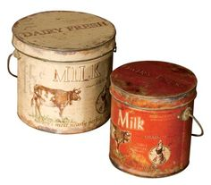"""Milk and cream cans are some of the most common dairy antiques.  Until the adoption of farm bulk tanks and tanker trucks in the 1940's and 50's milk was stored, cooled and transported in cans.  Of course the problem with milk cans was their lack of insulation.  On warm days the milk in the cans also became warm and started to sour.  Companies did sell canvas jackets for milk cans to help insulate them but they were not commonly used."""