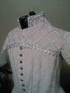 Pink velvet Elizabethan doublet, showing beadwork detail on shoulders and collar