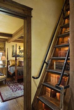 Stairs with books in risers. Metal railing. Designed by Locati Interiors.
