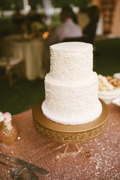 Simple White Tiered Wedding Cake On Gold Loopy Plate By Ont Treasures Photos