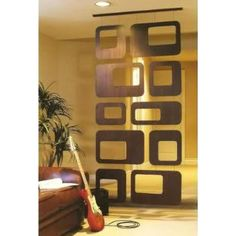 great way to divide a large room or a space that is awkward shape-wise to decorate Mid Century Style, Mid Century Modern Design, Mid Century House, Mid Century Modern Mirror, Room Divider Screen, Room Screen, Room Divider Bookcase, Room Divider Walls, Divider Cabinet
