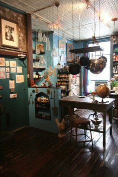 Eclectic kitchen. Love the glass jars hanging from the ceiling.