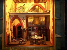 Colleen Moore's Castle, Kitchen.  The walls are painted with fables such as the story of the Grasshopper and the Ants and Mother Goose.