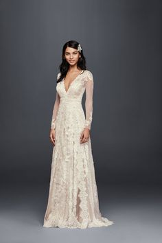 Beautiful bohemian inspired wedding dress | A-Line Long Sleeve Linear Lace Wedding Dress by Melissa Sweet available at David's Bridal Style MS251173