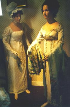 The gowns above are on display in Jane Austen's house, Chawton, England. Note the beautiful shawl and the draping detail on the bodice at the right. Image at Sense & Sensibility Patterns.