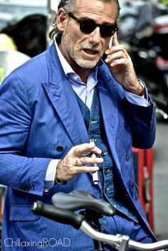 A very italian look. Who would have thought a jeans vest could look so stylish?