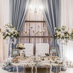 Ghost tables with white chair and pastel gray curtains will make a luxurious clean statement for your wedding ceremony table. Love it? Leave your comments below.  Photography: @anneedgarphoto / Design: @jodileighdesigns  Tag a friend who loves weddings! For more inspiration, follow:  @WeddingDream @TheBridestory @TheBrideBestFriend❤️