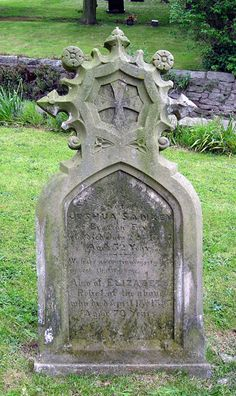 An unusual shaped headstone for Joshua Sankey in the churchyard of St Catherines Church, Eyton Upon The Weald Moors.