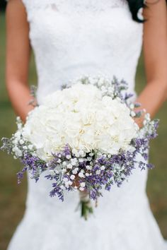 Bridal bouquet by Baumann's Florist. White hydrangeas, baby's breath, and sea lavender.