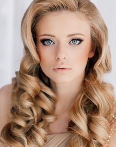 22 New Wedding Hairstyles to Try: I actually really like this one and the eye makeup as well