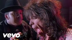 """Run-DMC - """"Walk This Way"""" ft Aerosmith. (Written by Stephen Tyler and Joe Perry in 1975, it peaked at 10 on Billboard Hot 100.  Re-released by Aerosmith in 1986, it went on to win the Soul Train Music Award for Best Rap-Single in 1987."""
