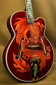 Here we have one of the most special guitars to come out of Gibson in recent memory: the Gibson Super 400 China Dragon.This one-of-a-kind carved masterpiece was Dragon Super, Custom Electric Guitars, Gibson Custom Shop, Archtop Guitar, Guitar Stand, Guitar Neck, Jazz Guitar, Vintage Guitars, Banjo