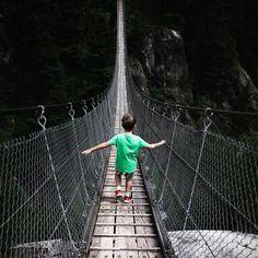 Keeping the balance My boy bravely crossing a canyon. Suspension Bridge, World Best Photos, Brooklyn Bridge, Railroad Tracks, Hammock, Behind The Scenes, Outdoor Decor, Photography, Travel