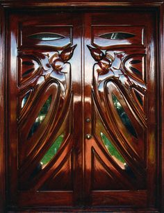 """""""Twin Swallows"""" by Fine Woodworks Custom Doors. These carved rustic wood double doors feature two swallows with glass accents. Made of Honduran Mahogany and Glass. Visit our website for additional photos and pricing. Wooden Double Doors, Wooden Doors, Entry Doors, Front Doors, Classic Doors, Modern Front Door, Art Deco Buildings, Rustic Doors, Custom Wood"""