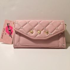 NWT Betsey Johnson Clutch/wallet  This is a lovely, feminine clutch that is brand new with tags. It's by Love, Betsey by Betsey Johnson. The strap is removable to use it as a wallet. the back pocket is large enough to fit most phones...my IPhone 6+ fits great! I love these types of clutches and have a few myself that I use when I just don't want to luv around my entire purse. Great for shopping and travelling! Betsey Johnson Bags Clutches & Wristlets
