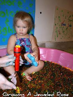 The motherload of baby sensory experiences - even though sitting in something slimy would be torture for lilly ;) Love that tap light in a storage container - perfect baby light box / table
