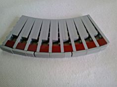 An easy way to cover the outer rim of a curve like this. Sadly the must be tiles, not plates, because they can freely slip on a stud. Lego Building, Legos, Creative Ideas, Tiles, Middle, Plates, Age, Cover, Projects
