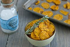 Crispy baked sweet potato chips brushed with garlic-infused olive oil and sprinkled with fresh rosemary and sea salt.