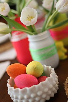 add a few eggs, first brushed with neon paint. Once dry, the eggs were coated with standard craft glue, then dusted with Martha Stewart neon glitter. Placed in a hobnop candy dish, for me it's the perfect blend of vintage modern.