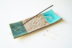 Ceramic incense burner/holder. Made from white clay and covered turquoise and green glaze. Dold bronze lace pattern.  Great for yoga, meditation or aroma