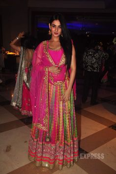 Sonal Chauhan was decked up in a multi-colored lehenga at a sangeet ceremony. #Bollywood #Fashion #Style #Beauty