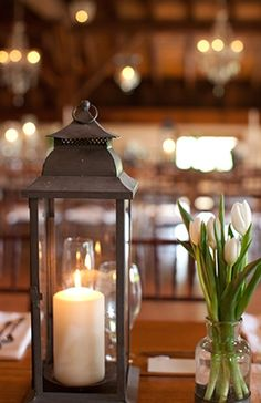 Shabby chic wedding table decor #lantern #tulips #centerpieces  Photo by: Pam Cooley on Snippet and Ink