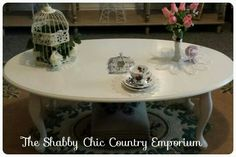 A lovely large coffee table with Queen Anne (Cabriole) legs. It has been lovingly restored to Shabby Chic, but more chic than shabby. The table top has been decoupaged with a gilded bird in a cage, and has had 3 coats of wax to seal.  115cms x 64cms x 42cms
