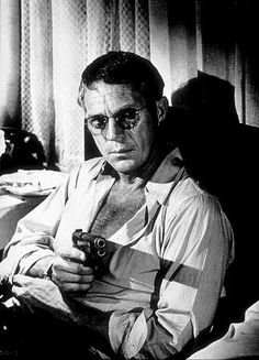 THE GETAWAY (1972) - Bankrobber Doc McCoy (Steve McQueen) means business with his Colt .45 automatic pistol - Based on novel by Jim Thompson - Directed by Sam Peckinpah - First Artists - Publicity Still.
