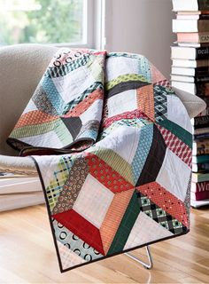 This quilt is a scrappy delight that's easy to customize with your own fabric choices.Quilt Designed by: Erica JackmanQuilt Size: 60